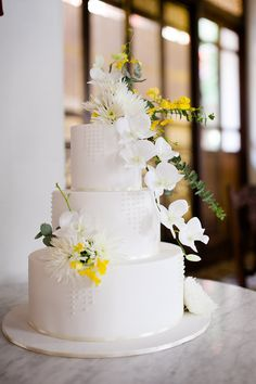 White tiered wedding cake with yellow and white flowers and foliage // Top 10 Wedding Cake Creators in Malaysia - Part 1