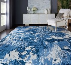 """TWI24 Twilight Blue Ivory - The classic combination of blue and white gets an exciting update in this beautifully abstract Twilight area rug. Like the """"field paintings"""" of modern masters, its rich indigo pigments create fascinating patterns on the ivory ground."""