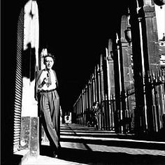 Lee Miller photograph of Jean Cocteau in the Palais Royal Arcades, 1944