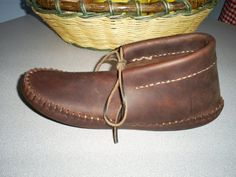 """HUNTERS MOCCASIN by garybord on Etsy, $75.00 """"DO YOU WANT QUIET COMFORTABLE BOW HUNTING???This handmade moccasin is made of tough oil tanned cowhide with a thick inner sole but not so thick that you can't feel the texture of the ground under your feet. The fringe has been removed to eliminate the possibility of snagging and snapping twigs. Comfortable and rugged this moccasin will last for many seasons. Designed by a hunter for a hunter."""""""