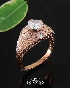 Custom 14kt rose gold antique style pierced mounting to hold a floral 4-prong set 6mm round cut stone.Start from scratch, and draw out the ring beside an artist who can make your dream ring come to life! We can also do this online, with a personal web page assigned to you and your designer. We also have live chat if you have ANY questions throughout the process or how to get started!. #rings #wedding #bling #diamond #diamondring #bride #inspiration #weddinginspiration #engagment
