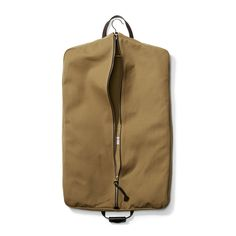 The Filson Twill Tan Suit Cover is water-repellent suit bag is sized for up to two garments and has a zipper pocket for smaller accessories. The Bridle Leather handle with two-snap grip folds this rugged bag in half for easy carrying. Mens Luggage, Luggage Bags, Latest Bags, Suit Covers, Garment Bags, Dark Tan, T Shirt And Jeans, Leather Handle, Suits