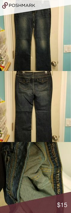 Simply Vera Vera Wang NWOT boot cut jeans This Simply Vera Vera Wang boot cut dark denim jeans are new without tags. It's slightly faded on the top. They're a size 8. There's a slight stretch to the jeans. There are flap pockets in the back. The material is 99% cotton and 1% spandex. Simply Vera Vera Wang Jeans Boot Cut