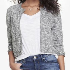 Cropped Bead Embellished French Terry Jacket Collarless. Open front. 3/4 sleeves. Faux pearl and bead embellishment at sleeve cuffs. Faux welt pocket details. Express Jackets & Coats