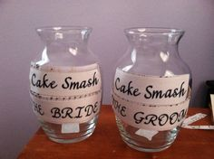 Cake smash idea... Help the Bride and Groom decide who gets cake smashed in their face at the reception by adding money to their jars. Whoever has the most dollar amout in their jar gets the cake in the face! Fun for guests and help for honeymoon cash