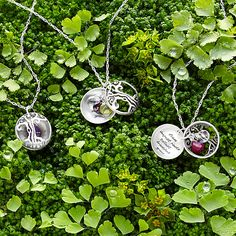 This locket honors motherhood with a tree of life motif, tree metaphor inscription, and family birthstones.
