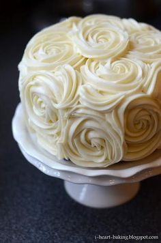 Red velvet cake w/cheescake middle and cream cheese buttercream roses - so pretty!