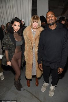 Chilly: Kim, wearing her husband's designs backstage at his Addidas show with Vogue Editor...