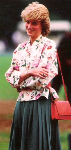 Diana in a flowered shirt with blue skirt. An outfit I haven't seen before.
