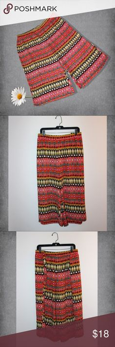 """Plus"" Chic Aztec Printed Cato Pants These pants are so much fun! Paired with a tank, and you are ready to go! About them:  * Colors - Red, yellow, aqua, orange, black, and white * Stretchy waistband * Loose fitting - not much stretch * Loose pleats * 100% polyester   MEASUREMENTS:  * Waist 42"" * Hips 60"" * Length 35.5""  These awesome pants are new without tags. They are by Cato and size 26/28W. Cato Pants Ankle & Cropped"