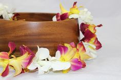 Unique to Aloha Island Lei, we methodically tint orchid flowers to match themed occasions and seasons. The search for the perfectly matching lei will be cul