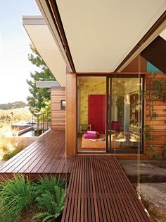Versatile use of different kinds of wood. Again perfect use of a sliding door.