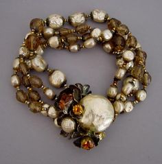 HASKELL brown glass beads and artificial pearls four-strand bracelet with ornate artificial pearls, topaz-colored faceted glass beads and rhinestones and gold tone flower petals, 7 by 1-1/4.