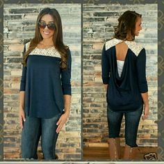 The Abby Lace Touch Blouse The Abby Lace Touch Long Sleeve Blouse Features the unique lace design all around neck that snaps on the back and gives a cowl silhouette design. Also features the trendy assymetrical hemline. Made up of comfy cotton material.  Available in S, M, L, XL, sizes  Navy blue Tops Blouses