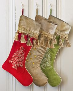 A perfect match to our Jeweled Christmas Tree Skirt, these exquisitely embellished stockings feature silky velvet fabric, a delightful embroidered Christmas tree design, faux crystal accents, and elaborate golden tassels.