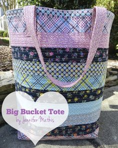 This fabulous Big Bucket Tote by Jennifer Mathis of Ellison Lane Quilts is made of up colorful jelly roll strips, making it a relatively quick sew.