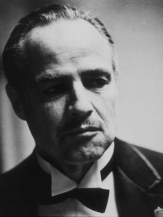 """The Godfather Fun Fact: Marlon Brando wanted to make Don Corleone """"look """"like a bulldog,"""" so he stuffed his cheeks with cotton wool for the audition. For actual filming, he wore a mouthpiece made by a dentist"""