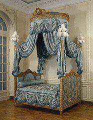 French, Paris, about 1775 - 1780  Painted and gilded walnut, gilded iron, modern silk upholstery and passementerie, and ostrich feathers. A grand bed like this one was meant to stand in a deep niche in the bedroom of the main apartment of a palace or mansion. In the 1700s, visitors were frequently received in the bedroom, while the host or hostess was still in bed or at his or her dressing table.