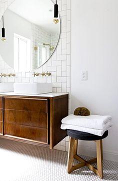 Golden round mirror pendant fixtures faucets in bathroom