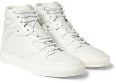 $645, White Leather High Top Sneakers: Balenciaga Embossed Leather High Top Sneakers. Sold by MR PORTER.