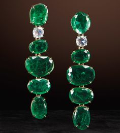 Marco Bicego - Unico - 18 karat yellow gold earrings with uneven cut emeralds and rose cut diamonds.