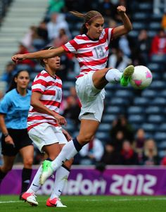 GLASGOW, SCOTLAND - JULY 28: Alex Morgan of USA strikes the ball during the Women's Football first round Group G match between United States and Colombia on Day 1 of the London 2012 Olympic Games at Hampden Park on July 28, 2012 in Glasgow, Scotland.