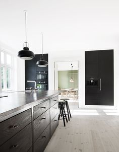Appliances disappear into cabinetry Black Kitchen Cabinets, Black Kitchens, Home Kitchens, Kitchen And Bath, New Kitchen, Dream Home Design, House Design, Masculine Interior, Kitchen Dining Living