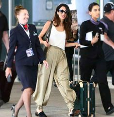 Amal Clooney attempts to make harem pants worth your while again. Seen here at the airport in Toronto.