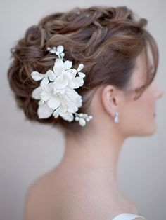 "Pretty, wavy updo with a great hairpiece.  Would need to be vigilant to avoid having the curls look like ""prom hair""."