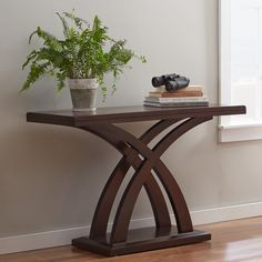 A curved x-shaped base fuses with a rich cherry finish to round out this eye-catching console table. Use it add sophisticated style to the living room then top it off with shimmering objets d'art for a dynamic display. Wood Table Decor, Console Table Decorating, Decor, Coffee Table Design, Table, Console Table Hallway, Coffee Table, Wood Table Design, Woodworking Furniture Plans