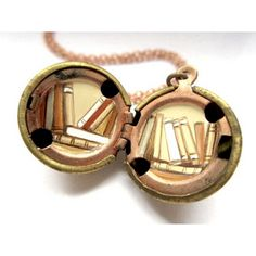 Coveting Khara Ledonne's books locket.