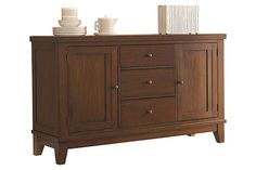 "The Holloway Dining Room Buffet from Ashley Furniture HomeStore (AFHS.com). With a warm cottage design bathed in a woody medium brown finish that flows beautifully over the thick profile table top, the ""Holloway"" dining collection captures an inviting relax style that is sure to fit comfortably within the décor of any home."