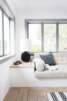 built-in seating window seat bench sofa table . built-in seating window seat bench sofa table lamp light fixture living room airy white linen Minimalism Interior, House Design, Interior, Interior Design Examples, Home Decor, House Interior, Built In Seating, Interior Design, Home And Living