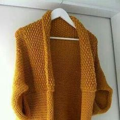 Easy to make http://www.violetlebeaux.com/2012/07/how-to-turn-a-knitted-blanket-into-batwing-cardigan/