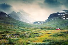 https://flic.kr/p/eFiZTJ | Store Skagastølstind | Shot on our way up the Sognefjell mountain road  framed by harsh peaks and mighty glaciers of Jotunheimen. It is actually the highest one in Northern Europe, reaching 1434m, connecting Gaupne and Lom. In the background, one can see the cloudcovered mountains of Hurrungane with the Store Skagastølstind.
