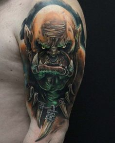 The Orc Tattoo on Shoulder by Timur Rumit is an impressively big and realistic portrait of Garrosh Hellscream - one of the World of Warcraft orc leaders. Blackout Tattoo, Rose Tattoos, Body Art Tattoos, Sleeve Tattoos, World Of Warcraft, Warcraft Orc, Horde Tattoo, Video Game Tattoos, Sick Tattoo