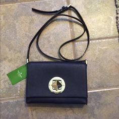 "NWT Kate spade cross body NWT Kate spade cross body in the color ""offshore"" which looks like a dark navy blue. Great to take on the go, the approximate size is height of 4.5"" length of 7.5"" and width of 1.25"". No trades. kate spade Bags Crossbody Bags"