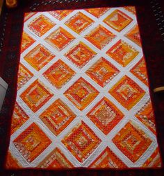 Orange String Quilt wide white stripes.  Do narrow white stripes with multi colors & flowers at intersections for Carly's quilt.