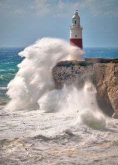 Under Strom, Gibraltar by Shane Busto on Coastal Pictures, Lighthouse Storm, Sea Storm, Beautiful Places, Beautiful Pictures, Seaside Garden, Lighthouse Pictures, Surf, Waves