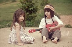 Do I know an old toddler boy who can play guitar? Hmm...