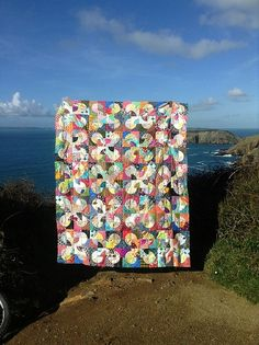 A happy, scrappy, sunny day quilt by Little Island Quilting.