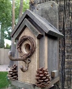 Here is a classic, rustic style that is easy to clean, and easy to mount. Two screws (included with your purchase) can easily attach this charming bird house to a tree or post. Made completely from rustic wood and decorated with real pinecones from our yard, plus a wreath around #birdhouses