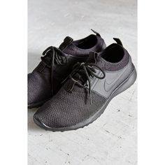 Nike Women's Juvenate Textile Sneaker ($90) ❤ liked on Polyvore featuring shoes, sneakers, black, black sneakers, nike trainers, rubber sole shoes, lightweight shoes and nike shoes