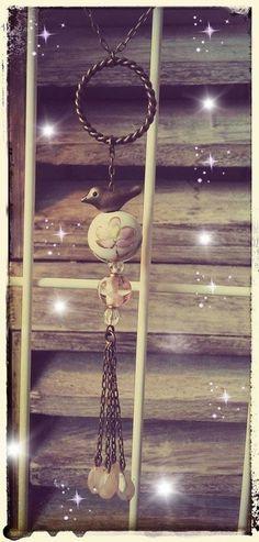 Sautoir vintage anneau tressé et oiseau