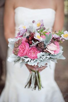 Beautiful hot pink juliet rose bouquet with berries and silver brunia.