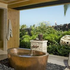Luxury Bathroom with Copper Tub and A Huge window with view of Garden nook area.