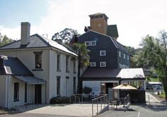 The heritage-listed Richies Mill complex overlooking the Tamar River.