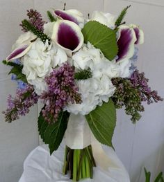 lilies, roses, hydrangeas, and lilacs | Lilacs, calla lilies, hydrangea and roses bridal bouquet