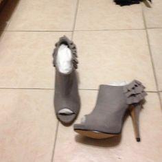 Light gray heels Light gray heels. Open toe. Suede. Ruffle design in back. Three inch heel  never been worn Shoes Heels