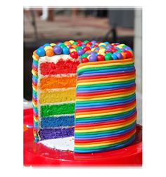 Colorful Rainbow Layered Birthday Cake with Candy on top! MMM....... BIRTHDAY FUN!